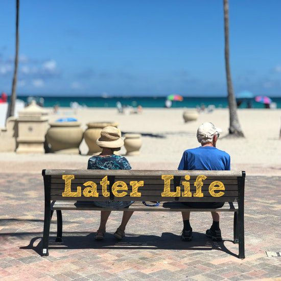 LAter life end of life couple sitting talking at beach